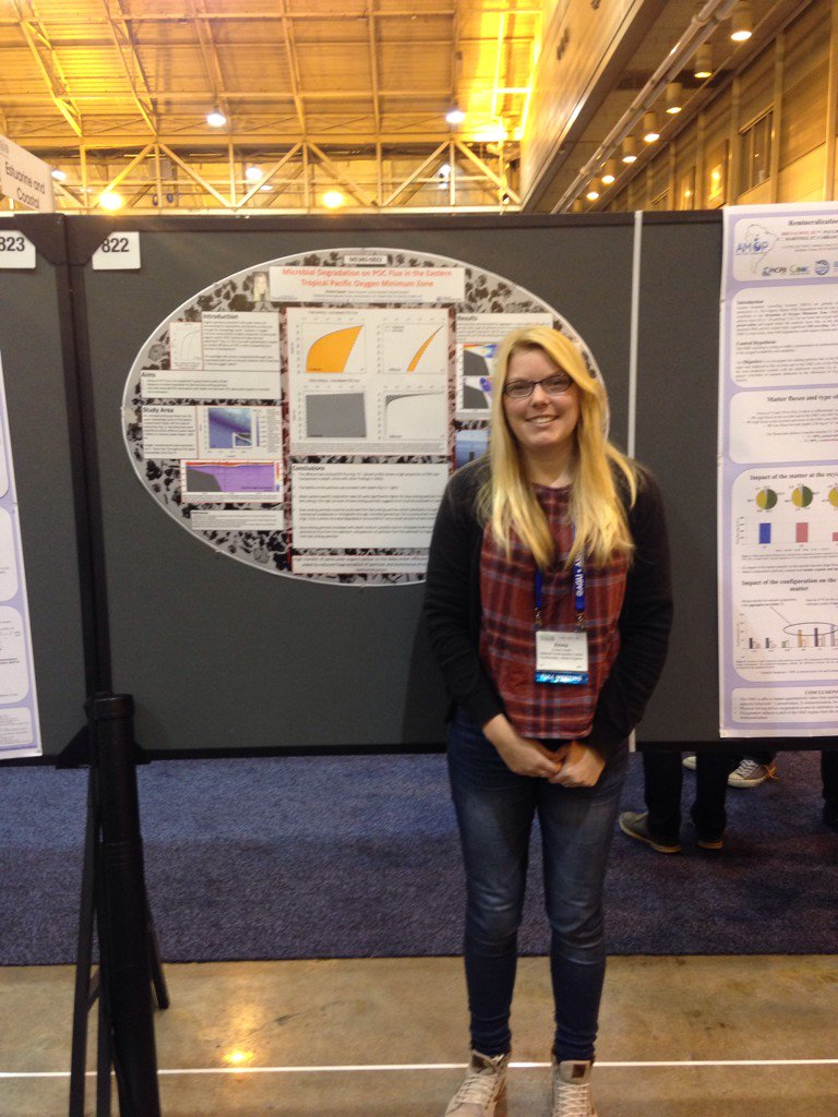 Me standing next to the only oval poster at the conference!